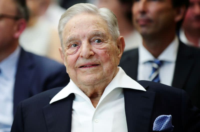 FILE PHOTO: Billionaire investor George Soros is awarded the Schumpeter Prize, an Austrian award for achievement in economics and politics, in Vienna, where the Central European University he funds is opening a new campus after being forced out of his nati