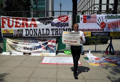 A man holds a sign during a protest against US President Donald Trump outside the US Embassy in Mexico City in March 2018 as the seventh round of NAFTA (North American Free Trade Agreement) talks took place in the city