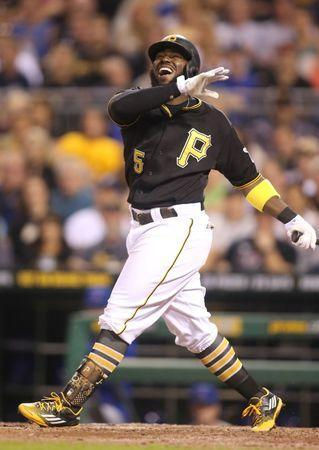 Sep 15, 2015; Pittsburgh, PA, USA; Pittsburgh Pirates second baseman Josh Harrison (5) reacts after striking out against Chicago Cubs starting pitcher Jon Lester (not pictured) during the eighth inning at PNC Park. Mandatory Credit: Charles LeClaire-USA TODAY Sports