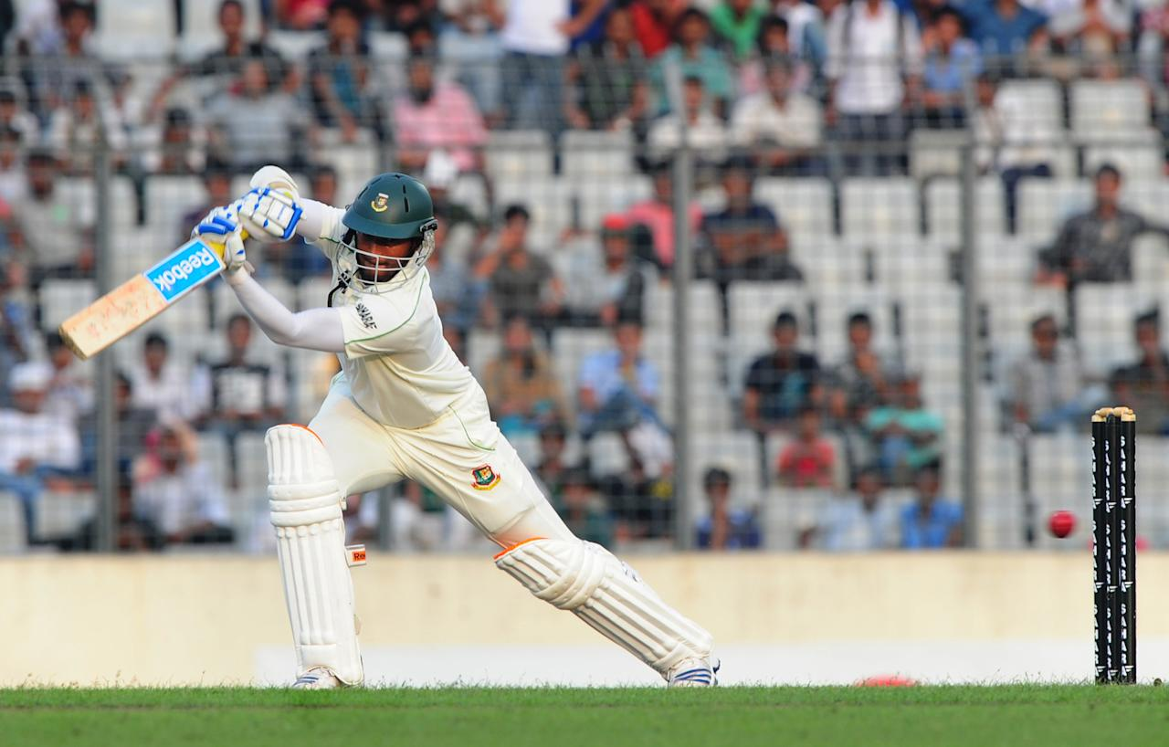 Bangladesh batsman Shakib Al Hasan plays a shot during the fourth day of the second Test match between Bangladesh and New Zealand at the Sher-e Bangla National Stadium in Dhaka on October 24, 2013.  AFP PHOTO/ Munir uz ZAMAN        (Photo credit should read MUNIR UZ ZAMAN/AFP/Getty Images)