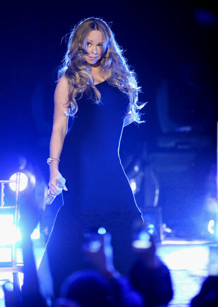 "Singer Mariah Carey performs at Caesars Entertainment ""Escape to Total Rewards"" kick-off at Gotham Hall on Thursday, March 1, 2012 in New York. (AP Photo/Evan Agostini)"