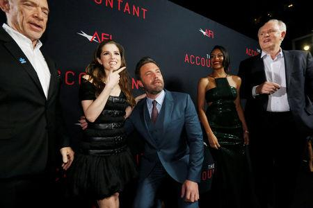 """Cast member Affleck poses with co-star Kendrick, as cast members Simmons, Addai-Robinson and Lithgow watch, at the premiere of """"The Accountant"""" at the TCL Chinese theatre in Hollywood"""