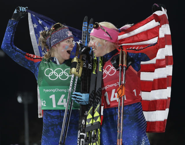 United States' Jessica Diggins, left, and Kikkan Randall celebrate after winning the gold medal. (AP Photo/Matthias Schrader)