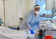A member of the medical personnel wearing a full protective suit works in the intensive care unit at Maastricht UMC+ Hospital