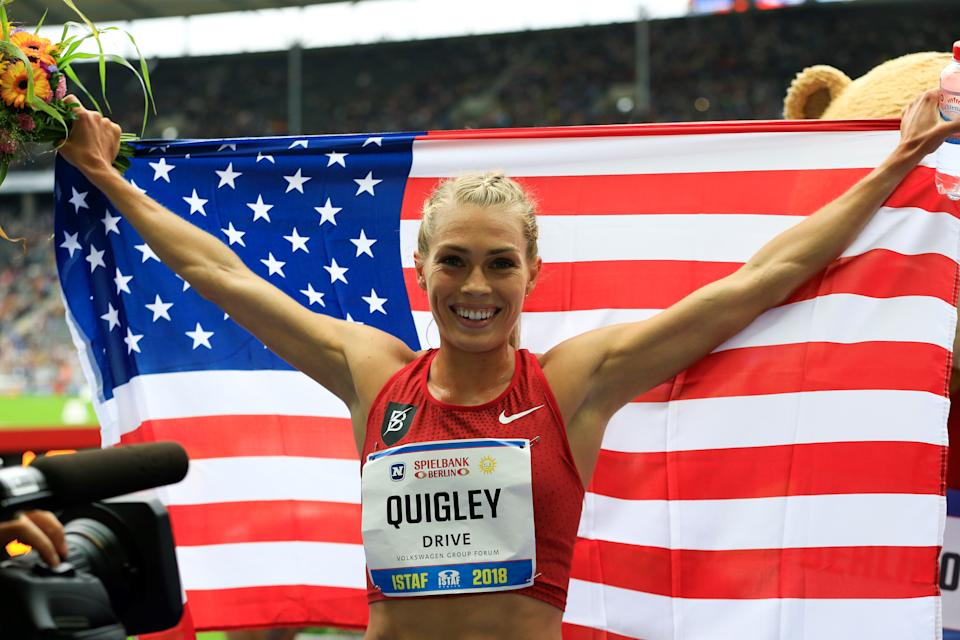 Steeplechaser Colleen Quigley poses with an American flag.