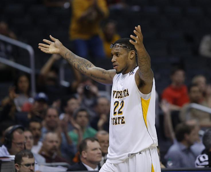 Wichita State's Carl Hall (22) celebrates his team's 72-58 victory over La Salle in their West Regional semifinal in the NCAA college basketball tournament, Thursday, March 28, 2013, in Los Angeles. (AP Photo/Jae C. Hong)