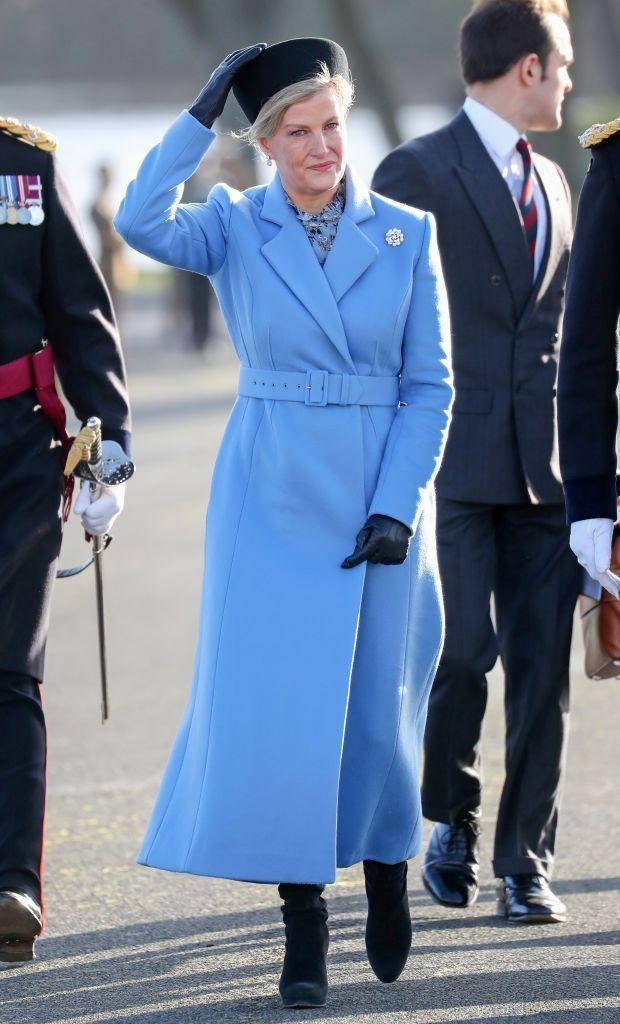 <p>The Countess knows how to elevate a winter look with a bright pop of color. She chose this blue, belted coat and pillbox hat for the Sovereign's Parade at the Royal Military Academy Sandhurst. </p>