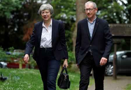 Britain's Prime Minister Theresa May arrives at  church with her husband Philip, near High Wycombe, Britain May 26, 2019.  REUTERS/Peter Nicholls