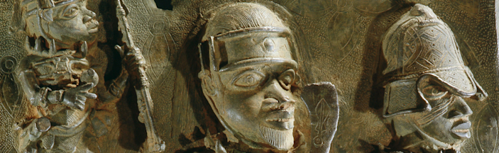 A Benin Bronze plaque depicting warriors of the oba on display at the British Museum