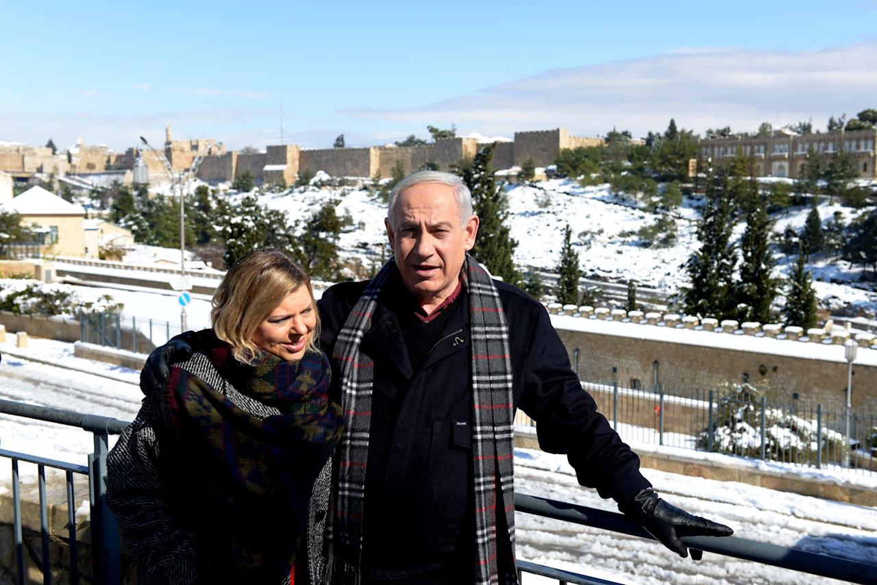 JERUSALEM, ISRAEL - JANUARY 10: (ISRAEL OUT) In this handout provided by the GPO, Israeli Prime Minister Benjamin Netanyahu enjoys the snow with his family on January 10, 2013 in Jerusalem, Israel.  Snow and strong winds have affected regions across the Middle East. (Photo by Avi Ohayon/GPO via Getty Images)