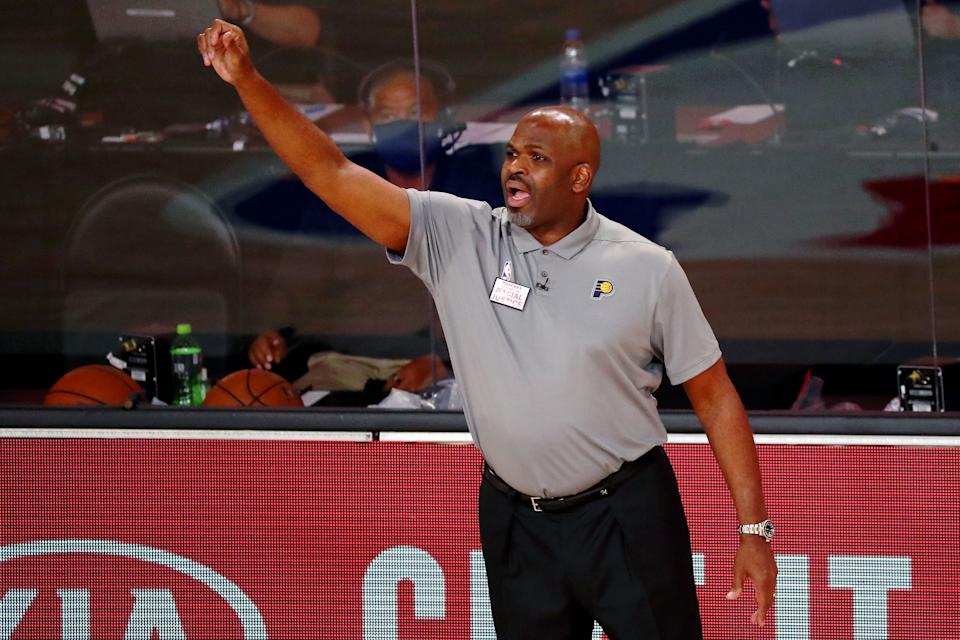 LAKE BUENA VISTA, FLORIDA - AUGUST 22:  Head coach Nate McMillan of the Indiana Pacers on the sideline during the second half of Game 3 of an NBA basketball first-round playoff series against the Miami Heat at AdventHealth Arena on August 22, 2020 in Lake Buena Vista, Florida. NOTE TO USER: User expressly acknowledges and agrees that, by downloading and or using this photograph, User is consenting to the terms and conditions of the Getty Images License Agreement. (Photo by Kim Klement - Pool/Getty Images)