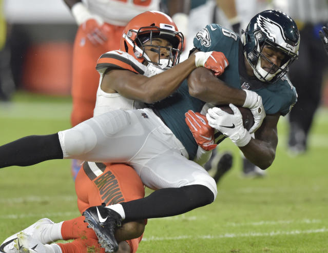 Philadelphia Eagles wide receiver Shelton Gibson, right, is tackled by Cleveland Browns cornerback Michael Jordan during the first half of an NFL preseason football game Thursday, Aug. 23, 2018, in Cleveland. (AP Photo/David Richard)