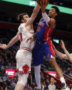 Detroit Pistons forward Christian Wood (35) attempts to shoot as Chicago Bulls forward Luke Kornet (2) defends during the first half of an NBA basketball game, Saturday, Jan. 11, 2020, in Detroit. (AP Photo/Carlos Osorio)