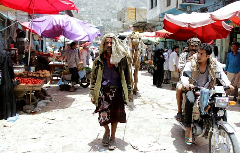 A Yemeni man walks with his camel through a market in the southwestern the city of Taez on May 13, 2015 as a five-day ceasefire took hold (AFP Photo/Abdel Rahman Abdallah)