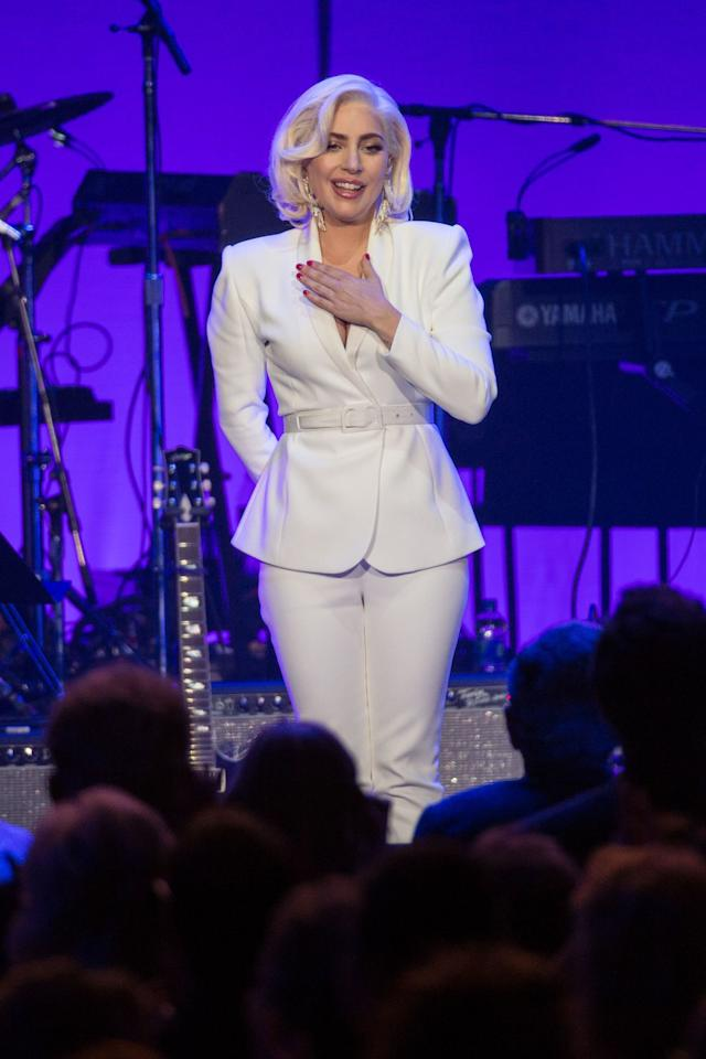 <p>Lady Gaga in a white suit for the relief concert in Houston, September 2017.</p>