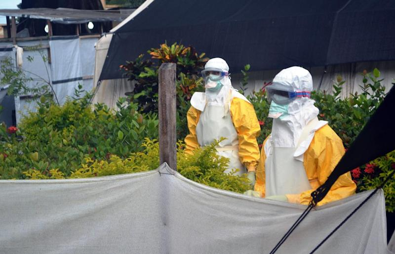 Members of Doctors Without Borders (MSF) wearing protective gear outside the isolation ward of the Donka Hospital, on July 23, 2014 in Conakry (AFP Photo/Cellou Binani)