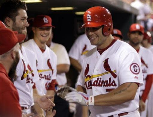 St. Louis Cardinals' Matt Holliday (7) celebrates with teammates after hitting a solo home run in the sixth inning of a baseball game against the Chicago Cubs, Thursday, June 20, 2013,in St. Louis. (AP Photo/Tom Gannam)