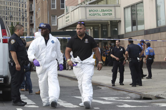 <p>Police officers with the Forensics Unit leave Bronx Lebanon Hospital after a gunman opened fire and then took his own life there, Friday, June 30, 2017, in New York. The gunman, identified as Dr. Henry Bello who used to work at the hospital, returned with a rifle hidden under his white lab coat, law enforcement officials said. (AP Photo/Mary Altaffer) </p>