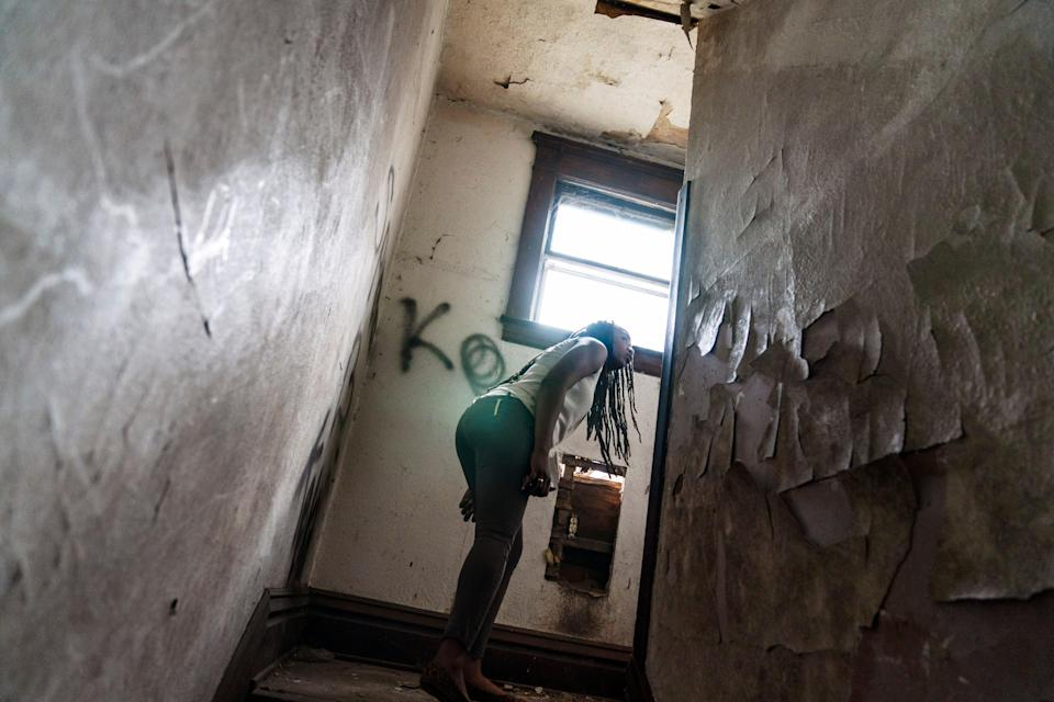 An overdose response team looks around an abandoned home in West Virginia (Associated Press)