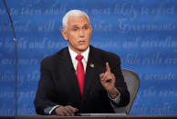 Vice President Mike Pence makes a point during the vice presidential debate with Democratic vice presidential candidate Sen. Kamala Harris, D-Calif., Wednesday, Oct. 7, 2020, at Kingsbury Hall on the campus of the University of Utah in Salt Lake City. (AP Photo/Julio Cortez)