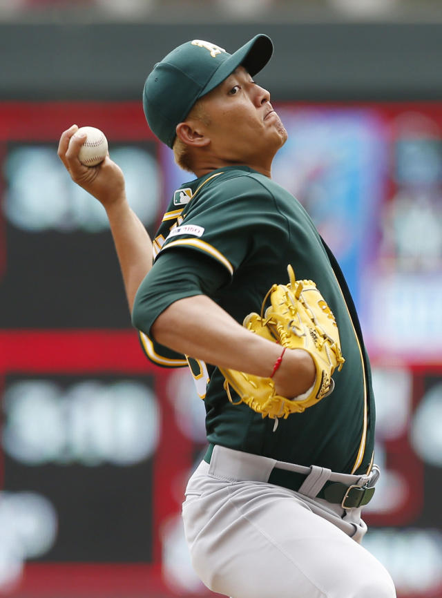 Oakland Athletics pitcher Wei-Chung Wang, of Taiwan, throws against the Minnesota Twins in the fifth inning of a baseball game Sunday, July 21, 2019, in Minneapolis. (AP Photo/Jim Mone)