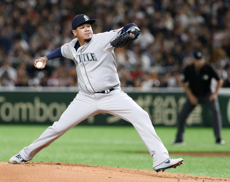 FILE - In this March 18, 2019, file photo, Seattle Mariners starter Felix Hernandez pitches against the Yomiuri Giants in the first inning of their preseason exhibition baseball game at Tokyo Dome in Tokyo. Mariners manager Scott Servais went away from tradition for his team's opener against the Oakland Athletics in Japan last week, bypassing Felix Hernandez, who had made 10 consecutive Game 1 starts, the longest active streak in the majors and surpassed by only four pitchers in history. (AP Photo/Toru Takahashi, File)