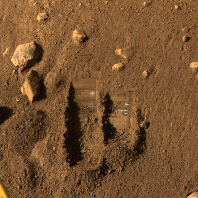 "NASA's Phoenix Mars Lander's Surface Stereo Imager shows two trenches dug by Phoenix's Robotic Arm in this image taken June 8, 2008, the 14th Martian day after landing. Soil from the right trench, informally called ""Baby Bear,"" was delivered to Phoenix's Thermal and Evolved-Gas Analyzer, or TEGA, on June 6, 2008. Picture taken June 8, 2008. REUTERS/NASA/JPL-Caltech/University of Arizona/Texas A&M University/Handout (UNITED STATES). FOR EDITORIAL USE ONLY. NOT FOR SALE FOR MARKETING OR ADVERTISING CAMPAIGNS."