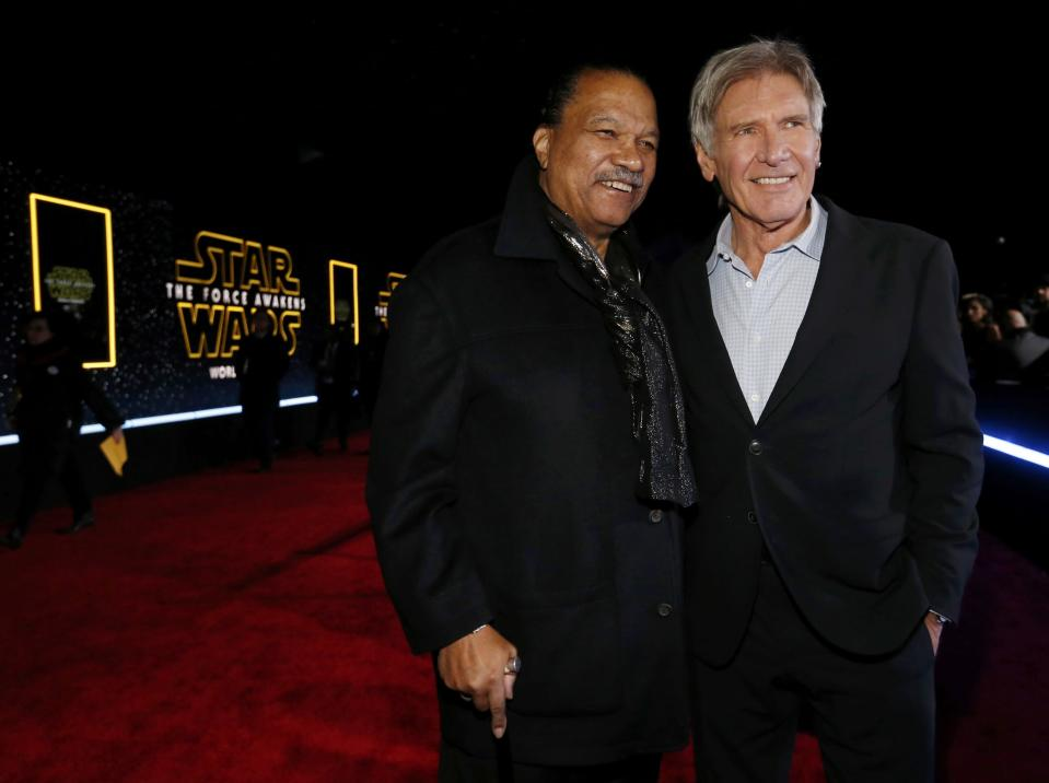 "Actors Billy Dee Williams (L) and Harrison Ford arrive at the premiere of ""Star Wars: The Force Awakens"" in Hollywood, California December 14, 2015. REUTERS/Mario Anzuoni"
