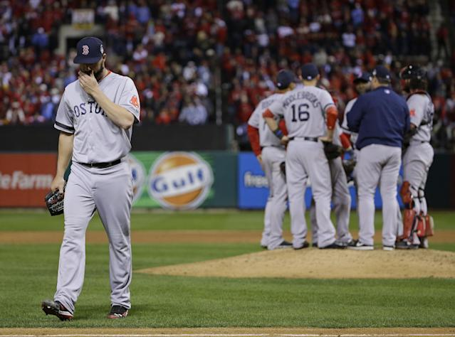 Boston Red Sox relief pitcher Brandon Workman walks off after being taken out of the game during the ninth inning of Game 3 of baseball's World Series against the St. Louis Cardinals Saturday, Oct. 26, 2013, in St. Louis. (AP Photo/Matt Slocum)