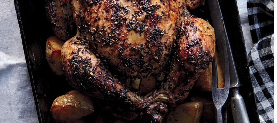 """How is a three-hour chicken better than a one-hour chicken? The fall-apart texture, for one thing. But the thing that really makes this chicken blissful is the fact that you can take a nap while it cooks. <a href=""""https://www.epicurious.com/recipes/food/views/herbed-faux-tisserie-chicken-and-potatoes-51224020?mbid=synd_yahoo_rss"""" rel=""""nofollow noopener"""" target=""""_blank"""" data-ylk=""""slk:See recipe."""" class=""""link rapid-noclick-resp"""">See recipe.</a>"""
