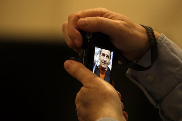 """A journalist takes a picture of Italy's coach Cesare Prandelli during a press conference at the foreign press club in Rome, Tuesday, Dec. 3, 2013. Italy coach Cesare Prandelli is hoping for a law change that would allow children of immigrants to play for the country's national teams before they turn 18. That's a chance that Mario Balotelli never had. Speaking at the Foreign Press Association on Tuesday, Prandelli says """"other nations are ahead of us in this department. I think and hope that soon these new Italians will have a chance to gain citizenship."""" Under current law, children of legal immigrants born in Italy can only apply for citizenship once they turn 18. (AP Photo/Gregorio Borgia)"""