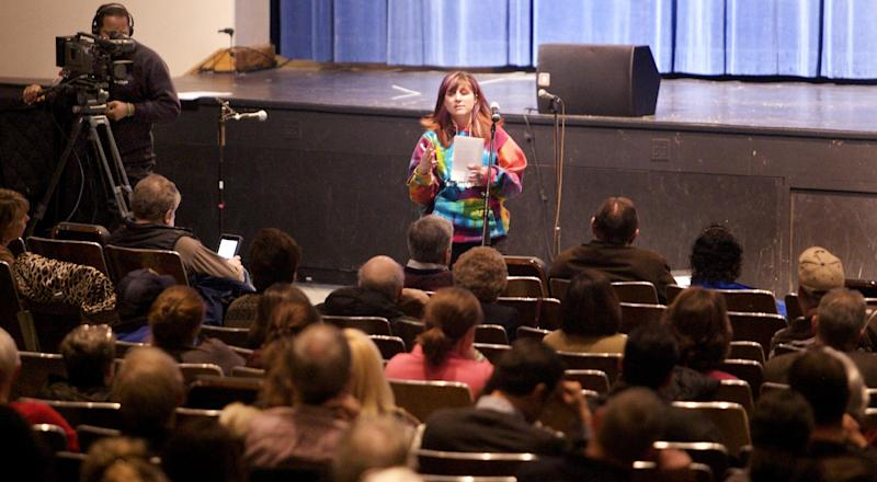 Kristen Kinsey, of Newtown, speaks during a community meeting at Newtown High School on the future of Sandy Hook Elementary School in Newtown, Conn., Sunday, Jan. 13, 2013. Talk about Sandy Hook Elementary School is turning from last month's massacre to the future, with differing opinions on whether students and staff should ever return to the building where a gunman killed 20 students and six educators. (AP Photo/Michelle McLoughlin, Pool)