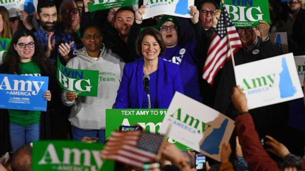PHOTO: Supporters hold signs for U.S. Democratic presidential candidate Senator Amy Klobuchar at her New Hampshire primary night rally in Concord, N.H., Feb. 11, 2020. (Gretchen Ertl/Reuters)