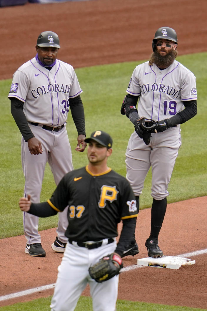 Colorado Rockies' Charlie Blackmon (19) stand next to third base coach Stu Cole (39) on third after hitting a triple off Pittsburgh Pirates starting pitcher Chase De Jong (37), driving in a run, during the fourth inning of a baseball game in Pittsburgh, Sunday, May 30, 2021. (AP Photo/Gene J. Puskar)
