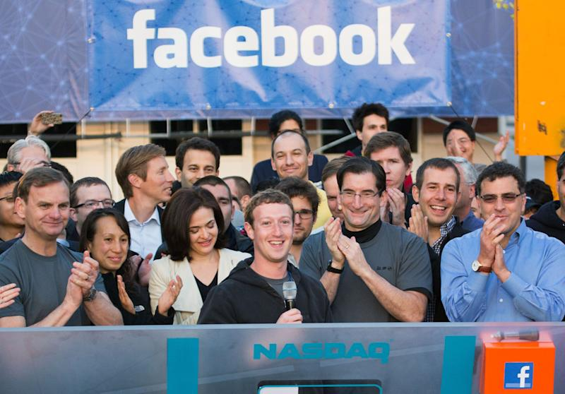 """FILE - In this May 18, 2012 file photo provided by Facebook, Facebook founder, Chairman and CEO Mark Zuckerberg, center, rings the Nasdaq opening bell from Facebook headquarters in Menlo Park, Calif. Robert Greifeld, second from right, CEO of the Nasdaq-OMX Stock Market, Inc., said Sunday, May 20, the stock exchange is """"humbly embarrassed"""" by its bungling of Facebook's debut. Facebook's stock was expected to start trading at 11 a.m. Friday, but didn't open until 11:32 a.m., and some investors didn't learn for hours whether their orders went through. (AP Photo/Nasdaq via Facebook, Zef Nikolla, File)"""