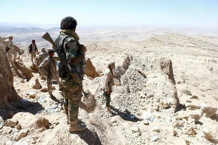 Yemeni soldiers stand on their position on a mountain on the frontline of fighting with Houthis in Nihem area, near Sanaa, Yemen January 27, 2018. Picture taken January 27, 2018. REUTERS/Faisal Al Nasser