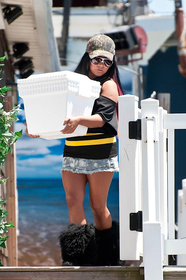 """Nicole """"Snooki"""" Polizzi was snapped doing some heavy lifting on Thursday in her signature furry boots. The pint-sized reality star was helping to load up the """"Jersey Shore"""" cast's Cadillac Escalade for a camping trip. <a href=""""http://www.infdaily.com"""" target=""""new"""">INFDaily.com</a> - July 27, 2011"""