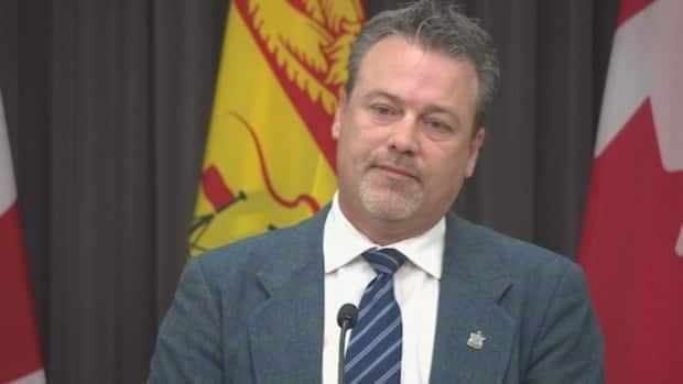 Natural Resources and Energy Development Minister Mike Holland said he was 'disappointed' with a federal Conservative party delegate vote to reject a motion that said climate change is real.