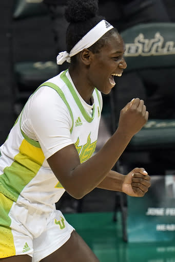 South Florida forward Bethy Mununga celebrates after making a three-point basket against the Baylor during the second half of an NCAA women's college basketball game Tuesday, Dec. 1, 2020, in Tampa, Fla. (AP Photo/Chris O'Meara)