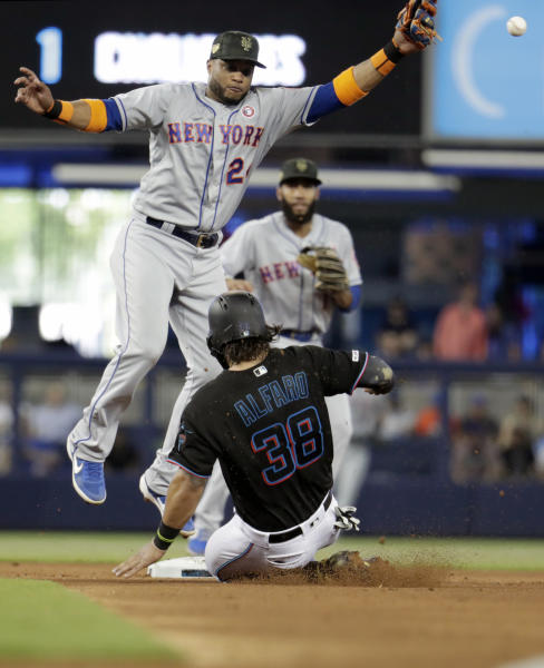 Miami Marlins' Jorge Alfaro (38) beats the throw to New York Mets second baseman Robinson Cano (24) to steal second in the fourth inning during a baseball game, Saturday, May 18, 2019, in Miami. (AP Photo/Lynne Sladky)