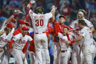 Philadelphia Phillies' Luke Williams is welcomed by teammates after his two-run home run during the ninth inning of a baseball game against the Atlanta Braves, Wednesday, June 9, 2021, in Philadelphia. The Phillies won 2-1. (AP Photo/Chris Szagola)