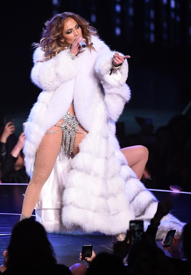 <p>Before things got really hot, Lopez took to the stage in a floor-length fur coat only giving the crowd a peek of her two-piece bedazzled bikini. <i>(Photo: Getty Images)</i></p>