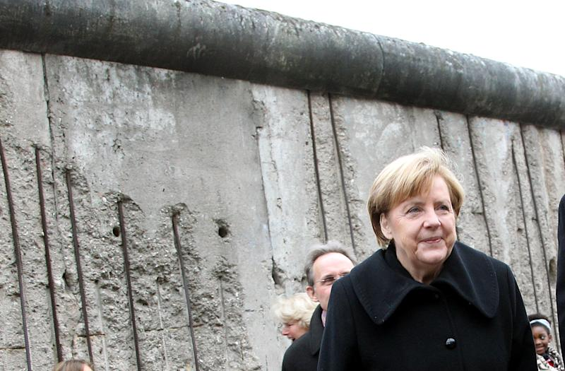 (FILE) - An archive picture dated 09 November 2014 shows German Chancellor Angela Merkel (CDU) participating in the central commemorative event of the State of Berlin and the federal government at the Berlin Wall Memorial at Bernauer Strasse in Berlin, Germany. Photo: Wolfgang Kumm/dpa | usage worldwide (Photo by Wolfgang Kumm/picture alliance via Getty Images)