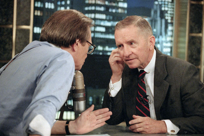 FILE - In this July 18, 1992 file photo, Larry King, left, talks with Texas billionaire Ross Perot during a commercial break in the live broadcast of CNN's 'Larry King Live' in New York. King, who interviewed presidents, movie stars and ordinary Joes during a half-century in broadcasting, has died at age 87. Ora Media, the studio and network he co-founded, tweeted that King died Saturday, Jan. 23, 2021 morning at Cedars-Sinai Medical Center in Los Angeles. (AP Photo/Alex Brandon, File)