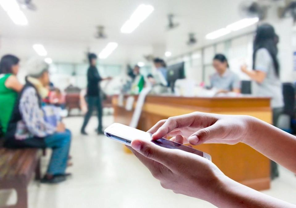 Man use mobile phone, blur image inside hospital