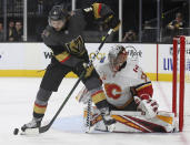 Vegas Golden Knights center Cody Glass (9) shoots on Calgary Flames goaltender David Rittich (33) during the second period of an NHL hockey game Saturday, Oct. 12, 2019, in Las Vegas. (AP Photo/Benjamin Hager)