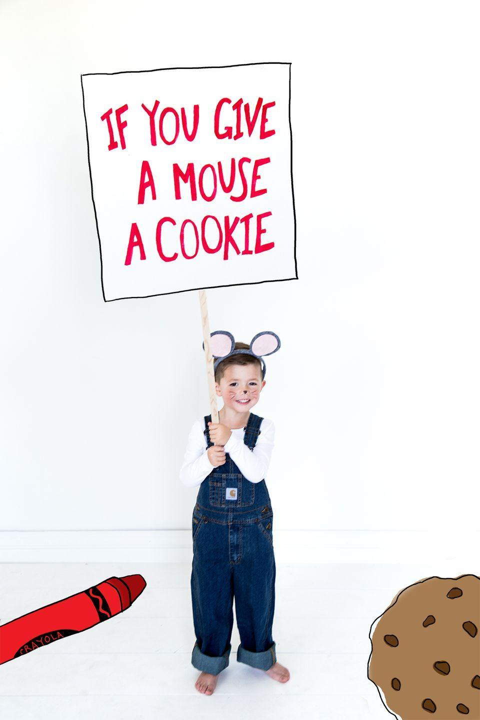 """<p>Don't settle for just any old mouse—turn your toddler into this famed children's book character with a sign and blue overalls. You can use a cookie as a prop too, but be wary of sugar overload on top of the Halloween candy...and know that it probably won't last long.</p><p><strong>Get the tutorial at <a href=""""https://thehousethatlarsbuilt.com/2015/10/if-you-give-a-mouse-a-cookie-costumes.html/#more-16309"""" rel=""""nofollow noopener"""" target=""""_blank"""" data-ylk=""""slk:The House That Lars Built"""" class=""""link rapid-noclick-resp"""">The House That Lars Built</a>. </strong> </p>"""