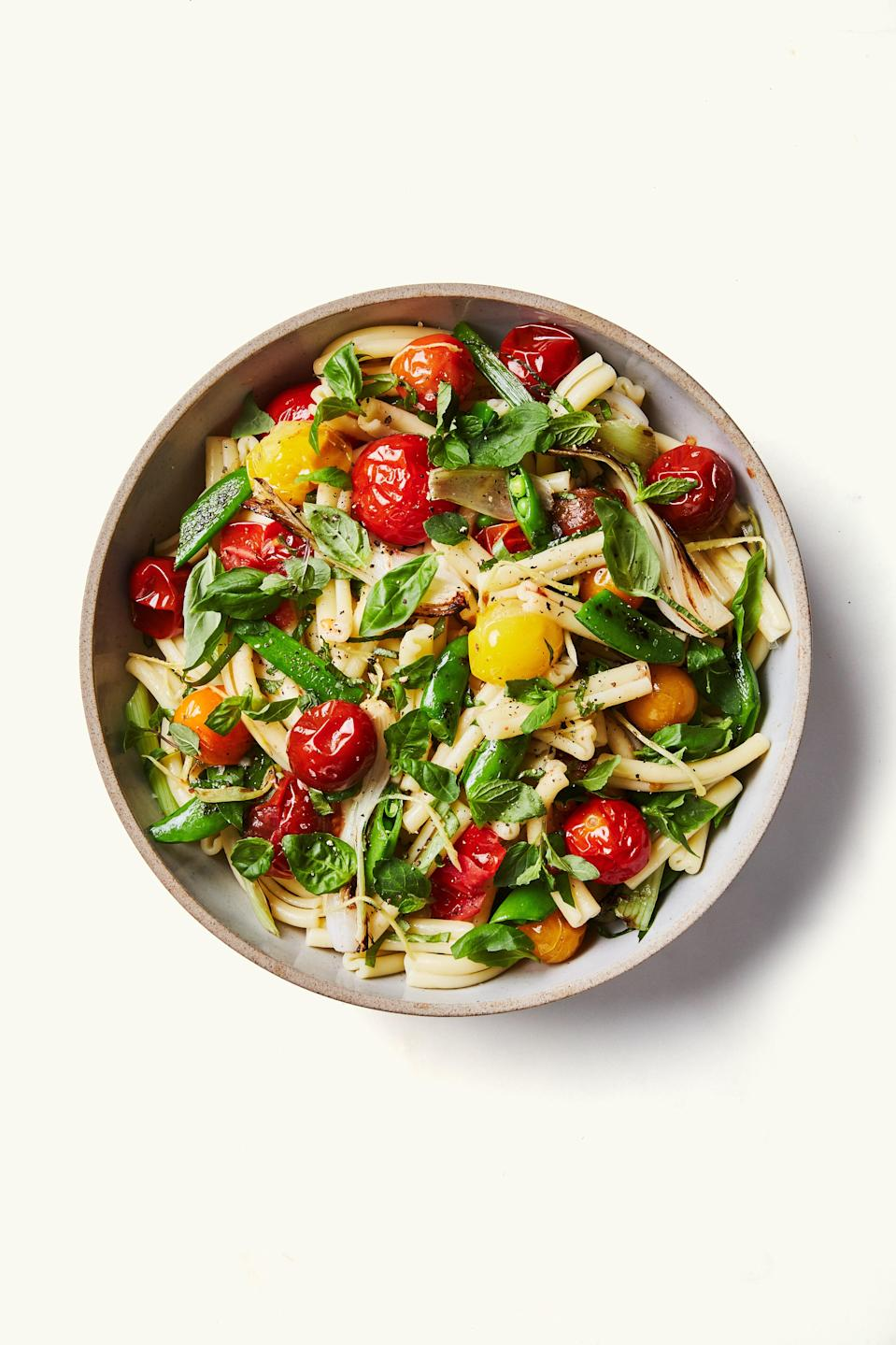 "Is it still pasta salad if it's not swimming in mayo? Why, yes it is. <a href=""https://www.bonappetit.com/recipe/pasta-salad-with-spring-vegetables-and-tomatoes?mbid=synd_yahoo_rss"" rel=""nofollow noopener"" target=""_blank"" data-ylk=""slk:See recipe."" class=""link rapid-noclick-resp"">See recipe.</a>"