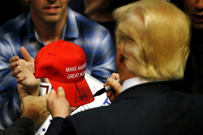 Trump signs a hat for a supporter after speaking at a campaign rally in Albany, N.Y., on April 11, 2016. (Eduardo Munoz Alvarez/Getty Images)