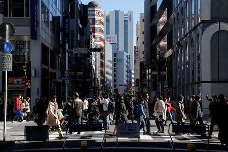 People walk on a street at Tokyo's Ginza shopping district, Japan, February 12, 2017. REUTERS/Toru Hanai